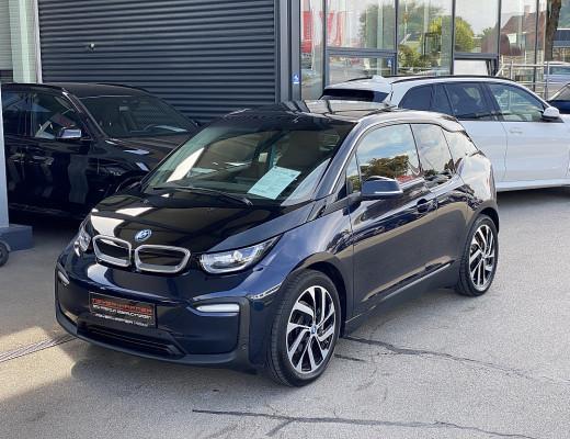 BMW i3 94 Ah eDrive Mega City Vehicle, Kamera, Komfortzugang, Glasdach, Navi-Pro, SHZ, 19″ bei CarPort || Meyer-Hafner in